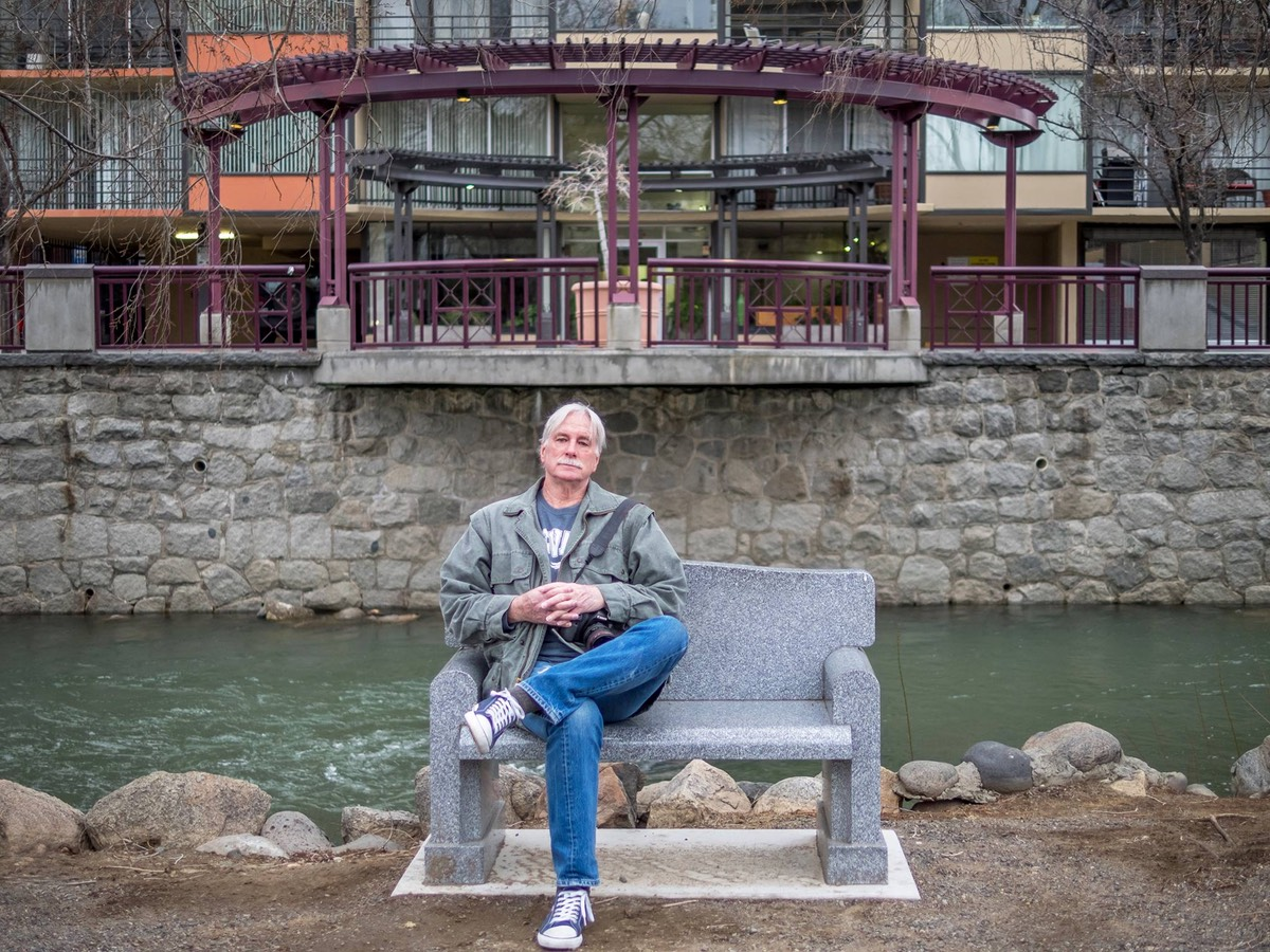 Ken Douglas Resting on a bench, by Vesta Irene. The bench is by the Truckee River. We've done a lot of engagement photography in this spot.