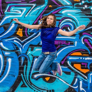 Selestiana jumping in Midtown, photographed by Ken Douglas and Vesta Irene of Wedding Shots, Wedding Photography, Reno, NV.